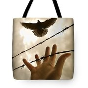 Hand Reaching Out For Bird Tote Bag