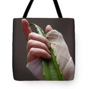 Hand With Bandage Holding Aloe Vera Leaf Tote Bag