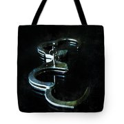 Handcuffs On Black Tote Bag by Jill Battaglia