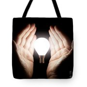 Hands Holding Light Bulb Tote Bag