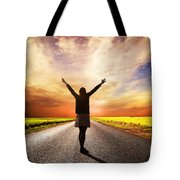 Happy Woman Standing On Long Road At Sunset Tote Bag