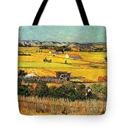 Harvest At La Crau With Montmajour In The Background Tote Bag by Vincent Van Gogh