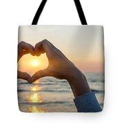 Heart Shaped Hands Framing Ocean Sunset Tote Bag