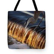 Heron Fishing At The Weir Tote Bag