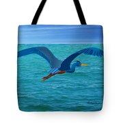 Heron Flying Over Ocean Tote Bag
