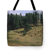 High Angle View Of Bisons Grazing Tote Bag