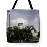 High Rise Buildings Behind Trees Along With Construction Work In Singapore Tote Bag