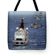 Hms Cornwall Is Pictured Receiving Stores By Merlin Helicopter  Tote Bag