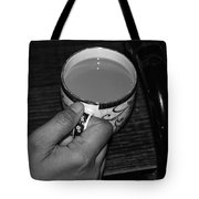 Holding A Full Cup Of Hot Tea Tote Bag