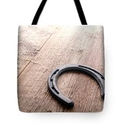 Horseshoe On Wood Floor Tote Bag