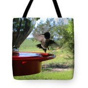 Hummingbird Flying To The Feeder Tote Bag