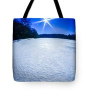 Ice And Snow Frozen Over Lake On Sunny Day Tote Bag