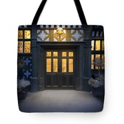 Illuminated Doorway To A Timber Framed Tudor House Or Mansion At Tote Bag