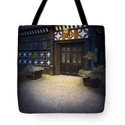 Illuminated Lamp Above The Doorway Of A Timber Framed Tudor Buil Tote Bag