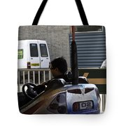 Indian Man Enjoying In A Bumper Cars Ride In An Entertainment Park Tote Bag