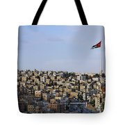 Jordanian Flag Flying Over The City Of Amman Jordan Tote Bag