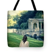 Lady Sitting On A Hill Above A Lake Tote Bag