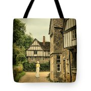 Lady Walking In The Village Tote Bag