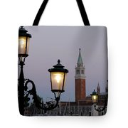 Lampposts Lit Up At Dusk With Building Tote Bag