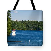Lighthouse And Boathouse Tote Bag