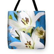 Lilies Against Blue Wall Tote Bag
