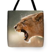 Lioness Displaying Dangerous Teeth In A Rainstorm Tote Bag