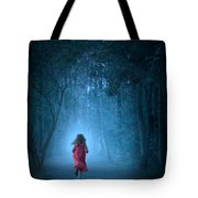 Little Girl In Red Dress Running In A Misty Forest Tote Bag
