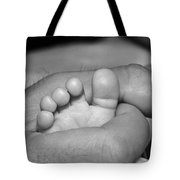 Tiny Infant Toes In Father's Big Hand Tote Bag