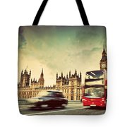 London The Uk Red Bus Taxi Cab In Motion And Big Ben Tote Bag