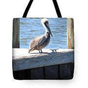 Lone Pelican On Pier Tote Bag