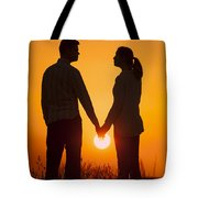 Lovers Holding Hands At Sunset In Silhouette Tote Bag