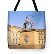 Low Angle View Of Statues In Front Of A Tote Bag