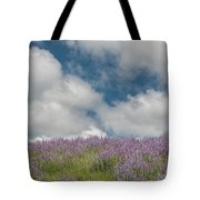 Lupine Field Under Clouds Tote Bag