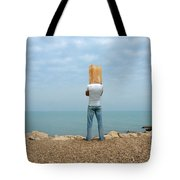 Man By The Sea With Bag On His Head Tote Bag