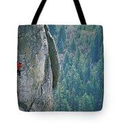 Man Climbing On A Big Granite Spire Tote Bag