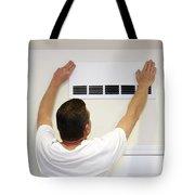 Man Covering Air Vent Tote Bag