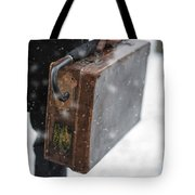 Man Holding A Vintage Leather Suitcase In Winter Snow Tote Bag