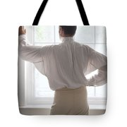 Man In Historical Shirt At The Window Tote Bag