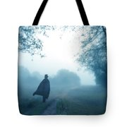 Man In Top Hat And Cape On Foggy Dirt Road Tote Bag