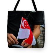 Man Plants Singapore Flag On Bicycle Tote Bag