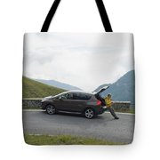 Man Rests On Trunk Of Car On Mountain Tote Bag