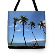 Man Riding Bicycle Beside Palm Trees Tote Bag