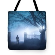 Man Standing In Foggy Gateway At Night Tote Bag
