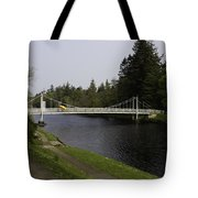 Man With Kayak Crossing Over Small Bridge From Ness Islands Tote Bag