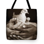 Many Hands Holding A Dove Tote Bag
