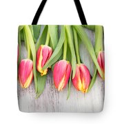 Many Spring Tulip Flowers On White Wood Table Tote Bag