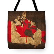 Map Of Canada With Flag Art On Distressed Worn Canvas Tote Bag by Design Turnpike