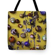 Marbles On Yellow Wooden Table Tote Bag