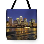 Moonrise Over River Thames Flowing Past Canary Wharf Tote Bag