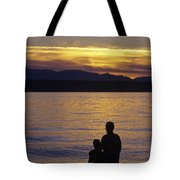 Mother And Daughter Holding Each Other Along Edmonds Beach At Su Tote Bag by Jim Corwin